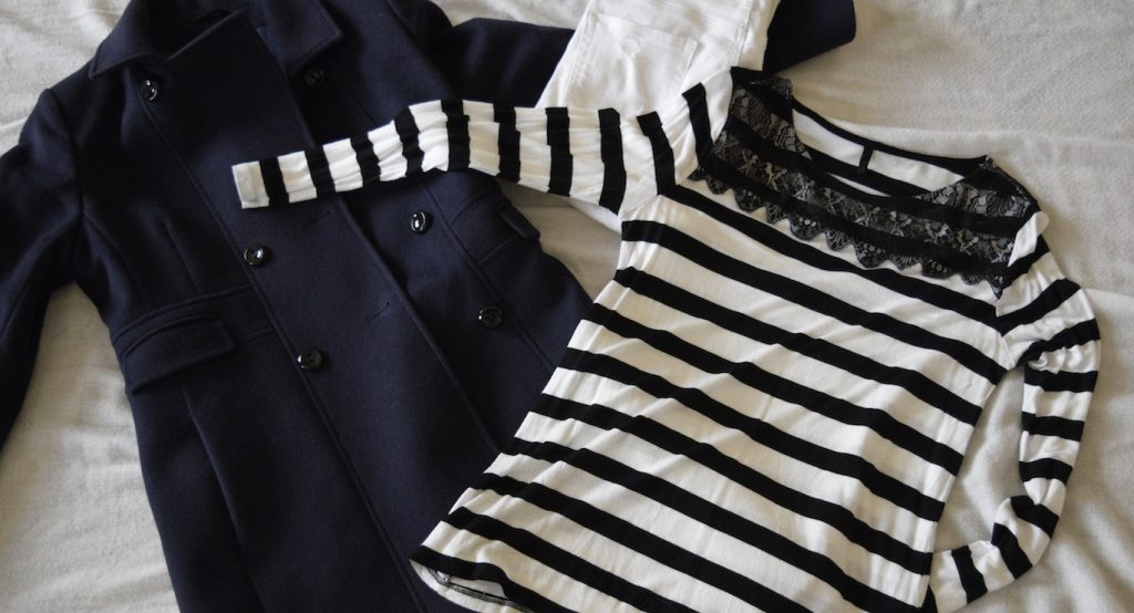 navy coat striped tee white jeans black booties